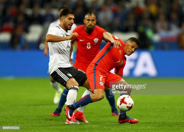Emre Can of Germany tackles Alexis Sanchez of Chile during the FIFA Confederations Cup Russia 2017 Group B match between Germany and Chile at Kazan...