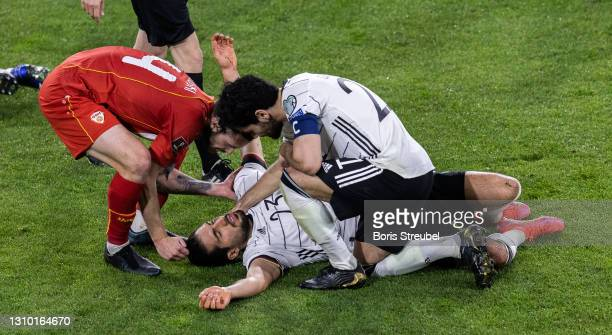 Emre Can of Germany takes an injury during the FIFA World Cup 2022 Qatar qualifying match between Germany and North Macedonia on March 31, 2021 in...