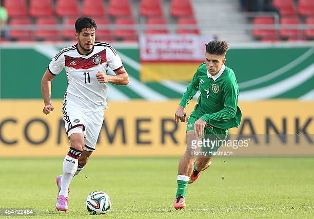 Emre Can of Germany vies with Jack Grealish of Ireland during the Under 21 Qualifier between Germany U21 and The Republic of Ireland U21 at Erdgas...