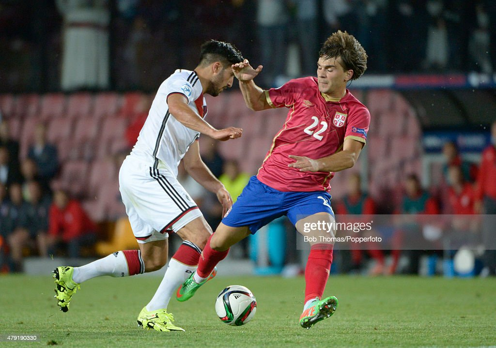 Emre Can of Germany with Filip Stojkovic (right) of Serbia during the UEFA European Under-21 Group A match between Germany and Serbia at Letna Stadium on June 17, 2015 in Prague, Czech Republic. The match was drawn 1-1. (Photo by Bob Thomas/Popperfoto/Getty Images).