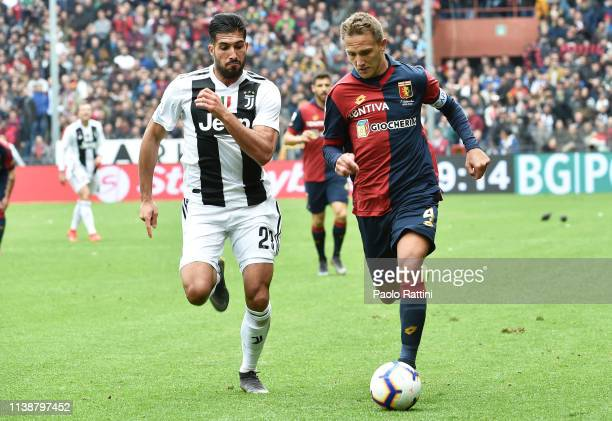Emre Can of Juventus challenges Domenico Criscito of Genoa during the Serie A match between Genoa CFC and Juventus at Stadio Luigi Ferraris on March...