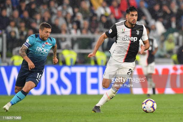 Emre Can of Juventus holds off the challenge from Alejandro Gomez of Atalanta during the Serie A match between Juventus and Atalanta BC on May 19...