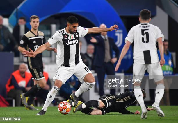Emre Can of Juventus is tackled by Lasse Schone of Ajax during the UEFA Champions League Quarter Final second leg match between Juventus and Ajax at...