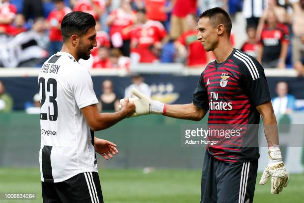 Emre Can of Juventus shakes hands with Odisseas Vlachodimos of Benfica during penalty kicks during the International Champions Cup 2018 match between...