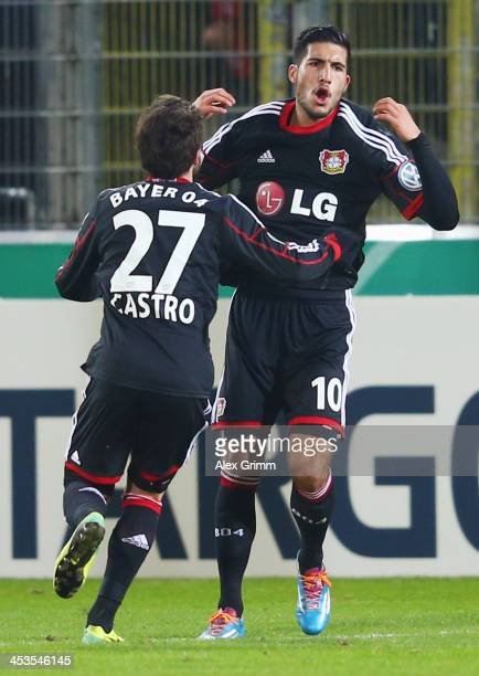 Emre Can of Leverkusen celebrates his team's second goal with team mate Gonzalo Castro during the German Cup Round of 16 match between SC Freiburg...