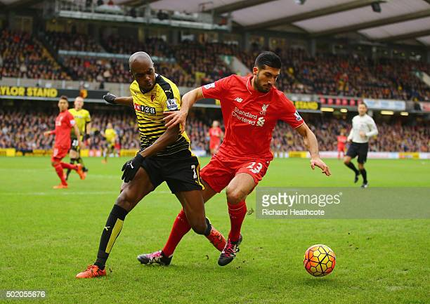 Emre Can of Liverpool and AllanRomeo Nyom of Watford battle for the ball during the Barclays Premier League match between Watford and Liverpool at...