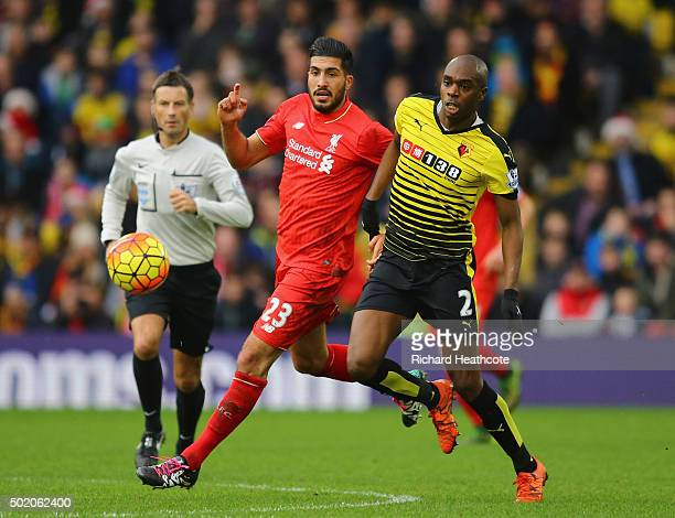 Emre Can of Liverpool and AllanRomeo Nyom of Watford watch the ball during the Barclays Premier League match between Watford and Liverpool at...