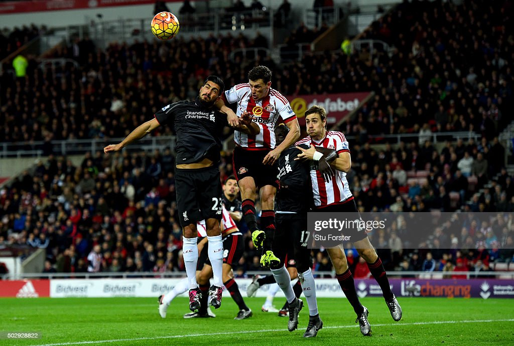 Emre Can of Liverpool and Billy Jones of Sunderland jump for the ball in front of Mamadou Sakho of Liverpool and Sebastian Coates of Sunderland during the Barclays Premier League match between Sunderland and Liverpool at Stadium of Light on December 30, 2015 in Sunderland, England.