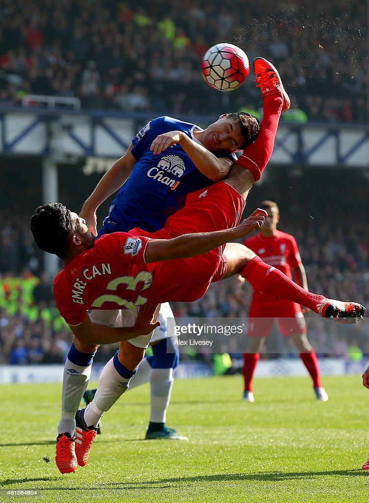 Emre Can of Liverpool and Ramiro Funes Mori of Everton in action during the Barclays Premier League match between Everton and Liverpool at Goodison Park on October 4, 2015 in Liverpool, England.