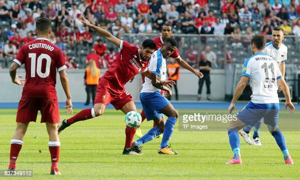 Emre Can of Liverpool and Salomon Kalou of Hertha battle for the ball during the Preseason Friendly match between Hertha BSC and FC Liverpool at...