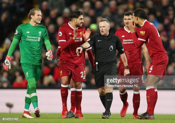 Emre Can of Liverpool and Trent Alex Arnold of Liverpool argue with referee Jonathan Moss after he awards Tottenham Hotspur a penalty during the...
