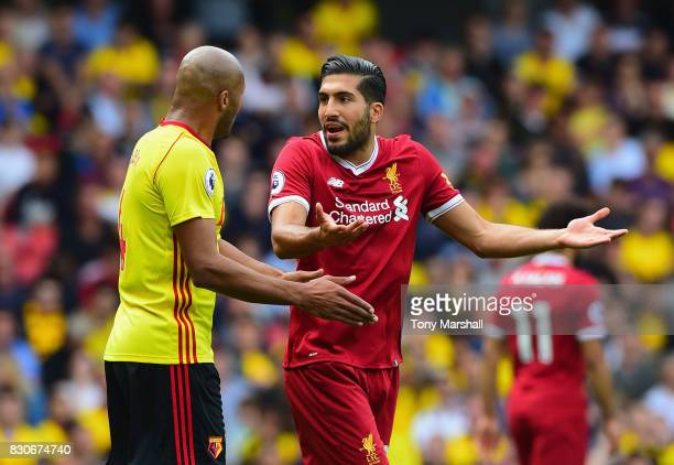 Emre Can of Liverpool and Younes Kaoul of Watford argue during the Premier League match between Watford and Liverpool at Vicarage Road on August 12...