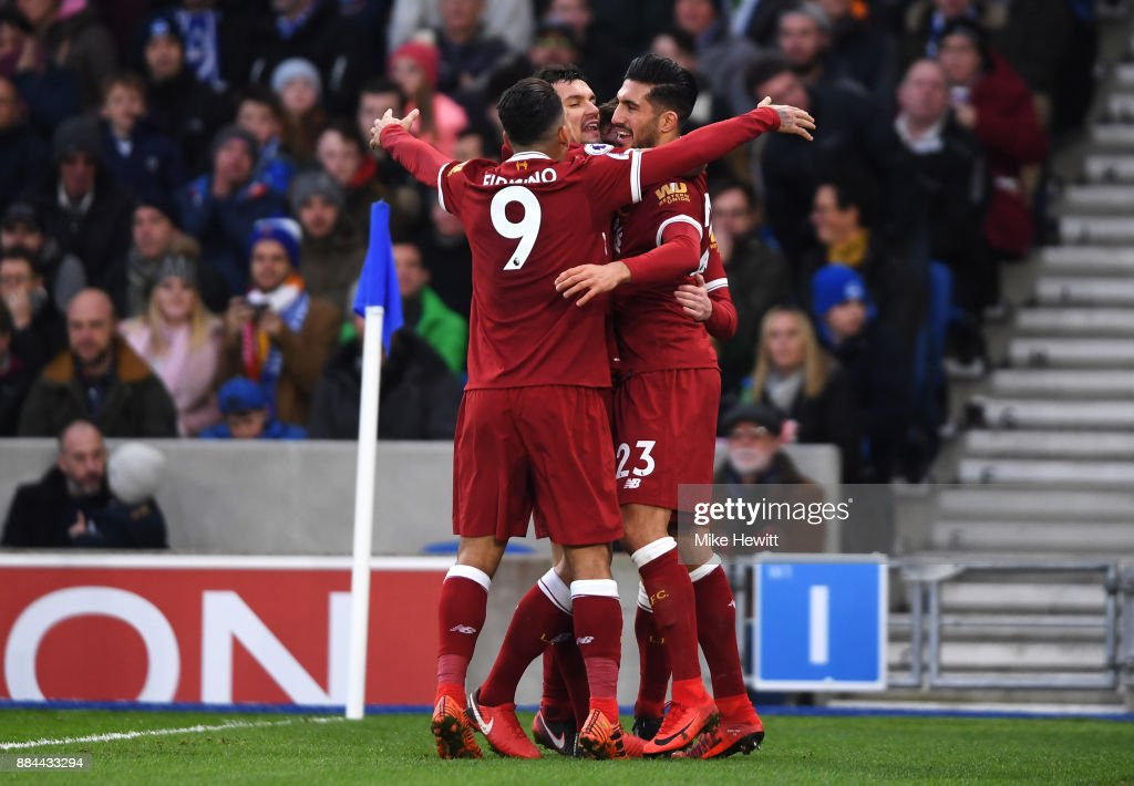Emre Can of Liverpool celebrates after scoring his sides first goal with Dejan Lovren of Liverpool and Roberto Firmino of Liverpool during the Premier League match between Brighton and Hove Albion and Liverpool at Amex Stadium on December 2, 2017 in Brighton, England.