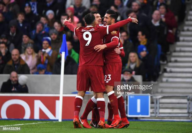 Emre Can of Liverpool celebrates after scoring his sides first goal with Dejan Lovren of Liverpool and Roberto Firmino of Liverpool during the...