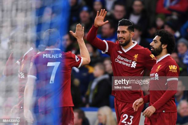 Emre Can of Liverpool celebrates after scoring his sides first goal with James Milner of Liverpool and Mohamed Salah of Liverpool during the Premier...