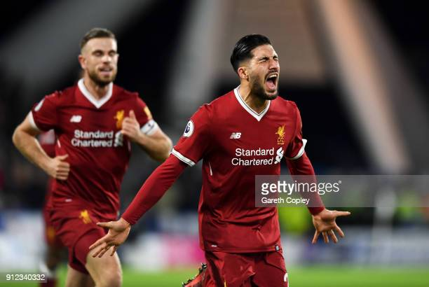 Emre Can of Liverpool celebrates as he scores their first goal with Jordan Henderson during the Premier League match between Huddersfield Town and...