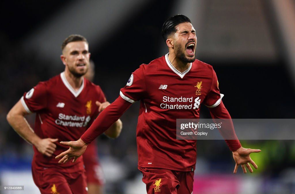 Emre Can of Liverpool (R) celebrates as he scores their first goal with Jordan Henderson during the Premier League match between Huddersfield Town and Liverpool at John Smith's Stadium on January 30, 2018 in Huddersfield, England.