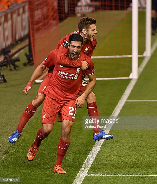 Emre Can of Liverpool celebrates his goal with Adam Lallana during the UEFA Europa League match between Liverpool FC and FC Rubin Kazan on October 22...