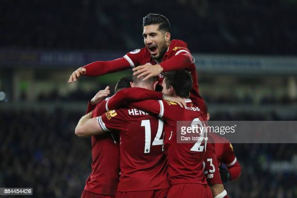Emre Can of Liverpool celebrates his sides fourth goal with Jordan Henderson of Liverpool during the Premier League match between Brighton and Hove...