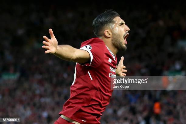 Emre Can of Liverpool celebrates scoring his sides first goal during the UEFA Champions League Qualifying PlayOffs round second leg match between...