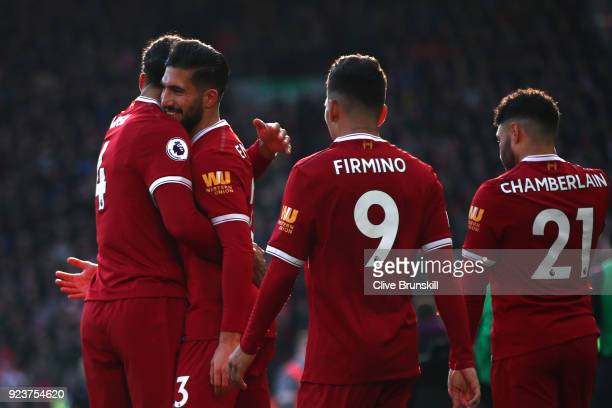 Emre Can of Liverpool celebrates scoring his side's first goal with team mates during the Premier League match between Liverpool and West Ham United...