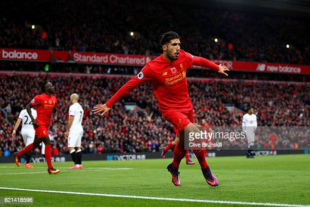 Emre Can of Liverpool celebrates scoring his sides third goal during the Premier League match between Liverpool and Watford at Anfield on November 6,...