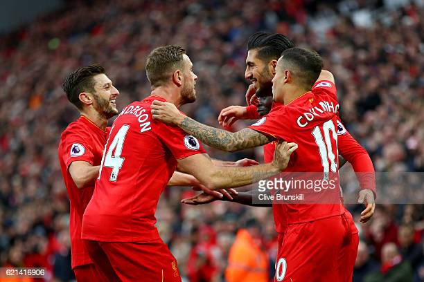 Emre Can of Liverpool celebrates scoring his sides third goal with team mates during the Premier League match between Liverpool and Watford at...