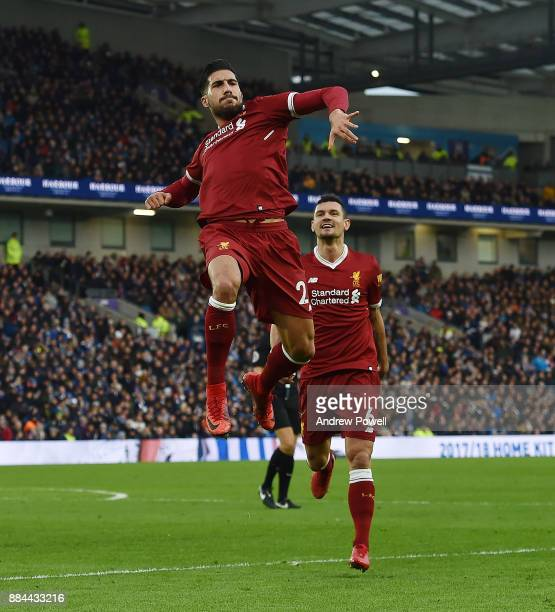 Emre Can of Liverpool Celebrates the opener for Liverpool during the Premier League match between Brighton and Hove Albion and Liverpool at Amex...