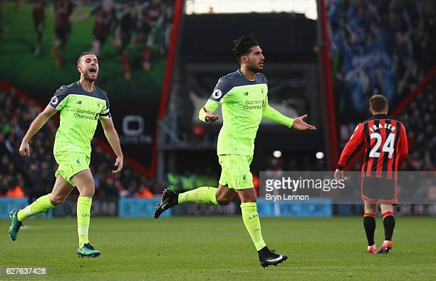 Emre Can of Liverpool celebrates with Jordan Henderson as he scores their third goal during the Premier League match between AFC Bournemouth and...