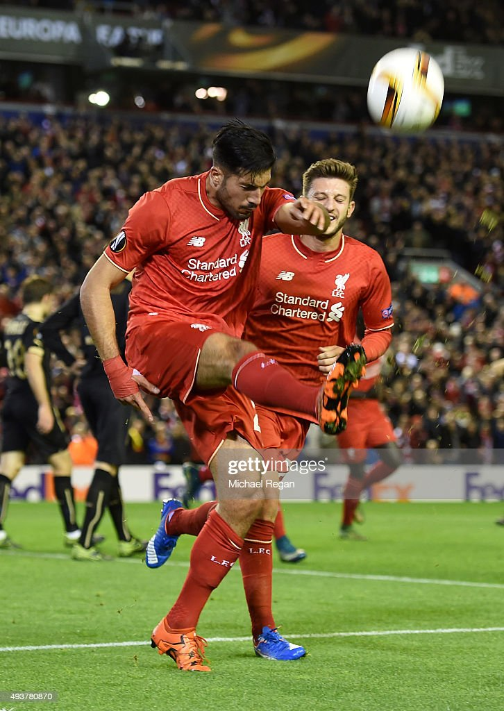 Emre Can of Liverpool celebrates with teammate Adam Lallana of Liverpool after scoring a goal to level the scores at 1-1 during the UEFA Europa League Group B match between Liverpool FC and Rubin Kazan at Anfield on October 22, 2015 in Liverpool, United Kingdom.