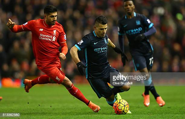 Emre Can of Liverpool challenges Sergio Aguero of Manchester City during the Barclays Premier League match between Liverpool and Manchester City at...