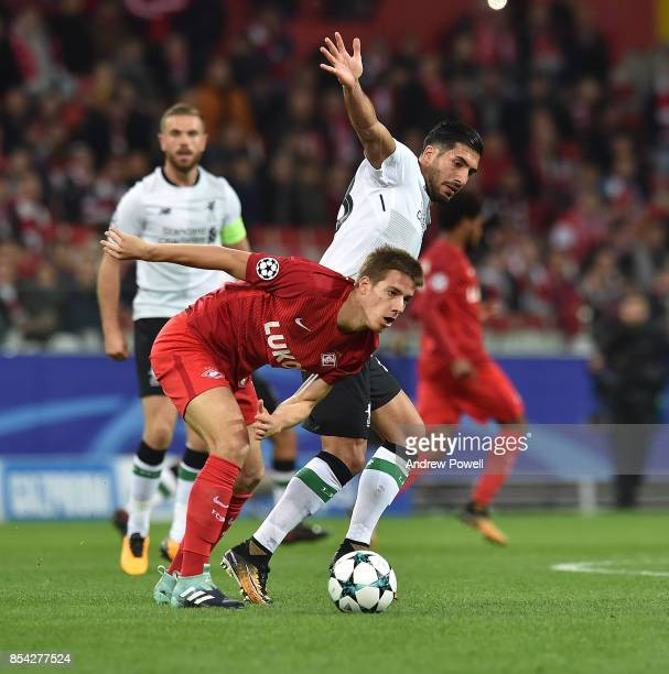 Emre Can of Liverpool competes with Mario Pasalic of Spartak Moskva during the UEFA Champions League group E match between Spartak Moskva and...