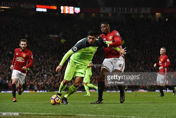 Emre Can of Liverpool competes with Paul Pogba of Manchester United during the Premier League match between Manchester United and Liverpool at Old...