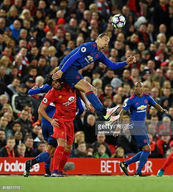 Emre Can of Liverpool competes with Zlatan Ibrahimovic of Manchester United during the Premier League match between Liverpool and Manchester United...