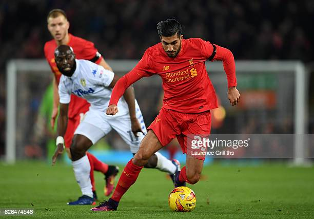 Emre Can of Liverpool evades Souleymane Doukara of Leeds United during the EFL Cup QuarterFinal match between Liverpool and Leeds United at Anfield...