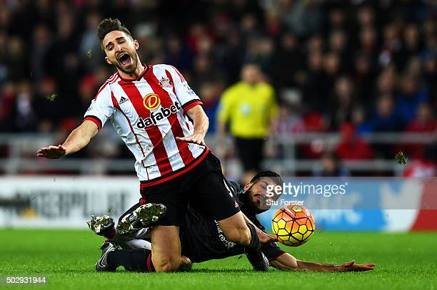 Emre Can of Liverpool fouls Fabio Borini of Sunderland during the Barclays Premier League match between Sunderland and Liverpool at Stadium of Light...