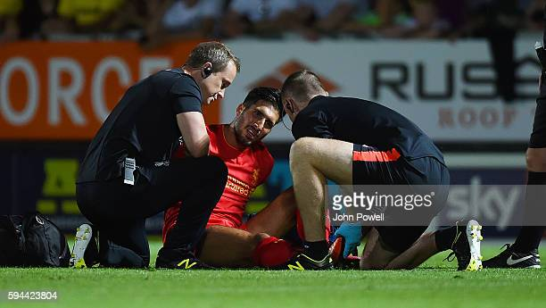 Emre Can of Liverpool get injured during the EFL Cup match between Burton Albion and Liverpool at the Pirelli Stadium on August 23 2016 in Burton...