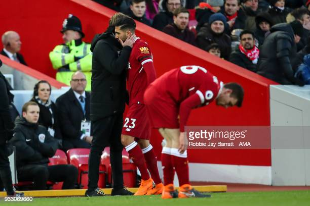 Emre Can of Liverpool gets substituted after picking up an injury during the Premier League match between Liverpool and Watford at Anfield on March...