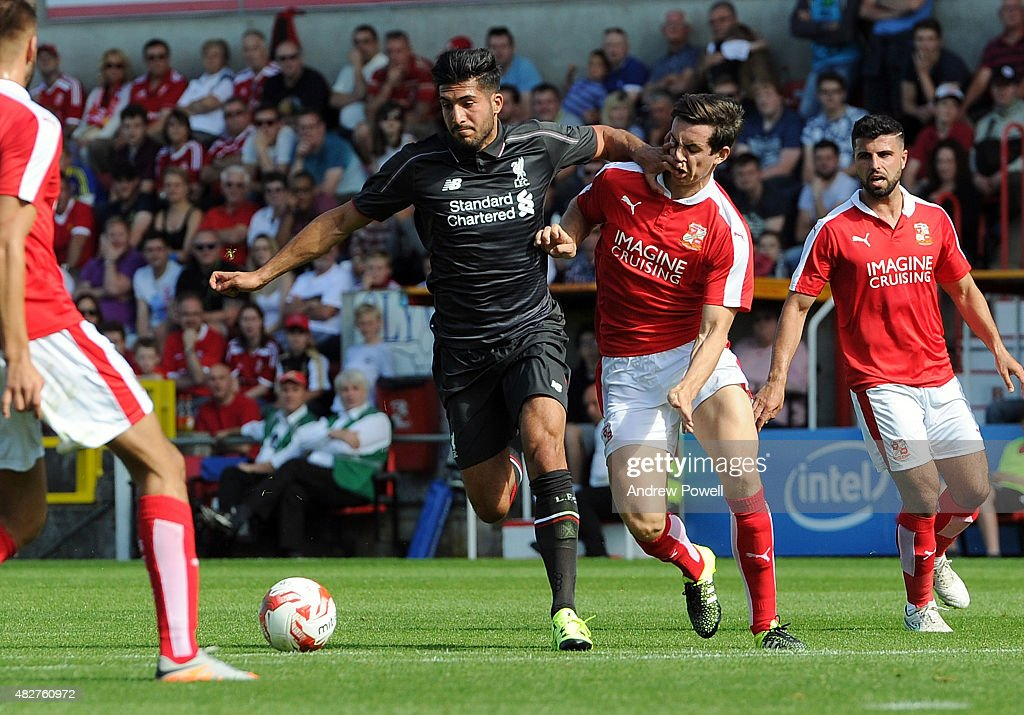 Emre Can of Liverpool in action with Michael Williams of Swindon Town during a preseason friendly at County Ground on August 2, 2015 in Swindon, England.