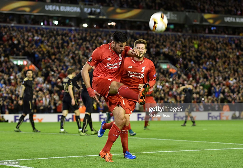 Emre Can of Liverpool is celebrates with teammate Adam Lallana of Liverpool after scoring a goal to level the scores at 1-1 during the UEFA Europa League Group B match between Liverpool FC and Rubin Kazan at Anfield on October 22, 2015 in Liverpool, United Kingdom.