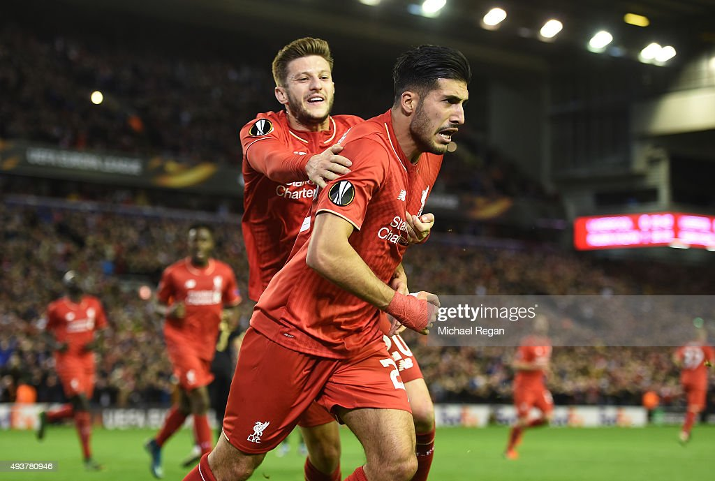 Emre Can (R) of Liverpool is congratulated by teammate Adam Lallana of Liverpool after scoring a goal to level the scores at 1-1 during the UEFA Europa League Group B match between Liverpool FC and Rubin Kazan at Anfield on October 22, 2015 in Liverpool, United Kingdom.