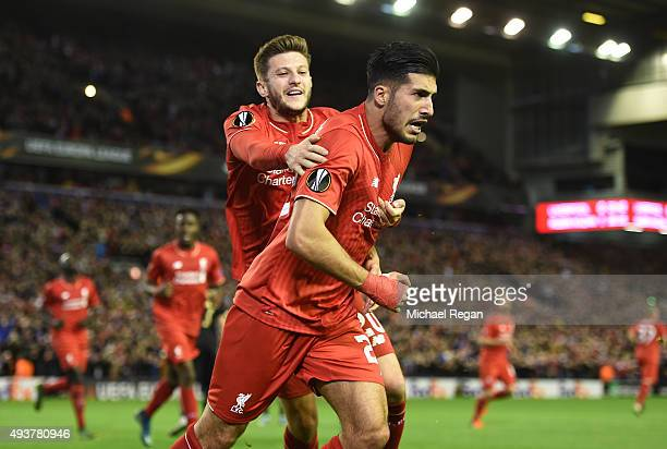 Emre Can of Liverpool is congratulated by teammate Adam Lallana of Liverpool after scoring a goal to level the scores at 11 during the UEFA Europa...