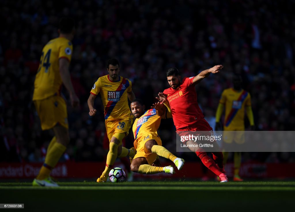 Emre Can of Liverpool is tackled by Jason Puncheon of Crystal Palace during the Premier League match between Liverpool and Crystal Palace at Anfield on April 23, 2017 in Liverpool, England.