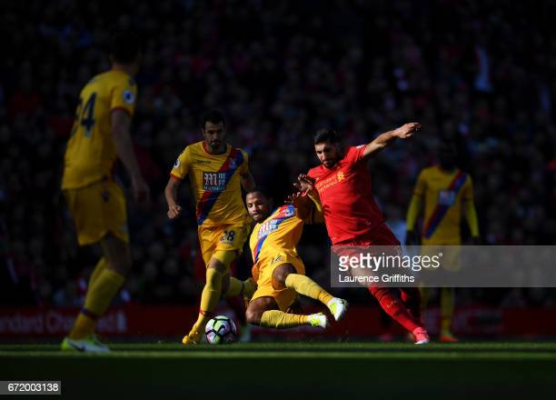 Emre Can of Liverpool is tackled by Jason Puncheon of Crystal Palace during the Premier League match between Liverpool and Crystal Palace at Anfield...