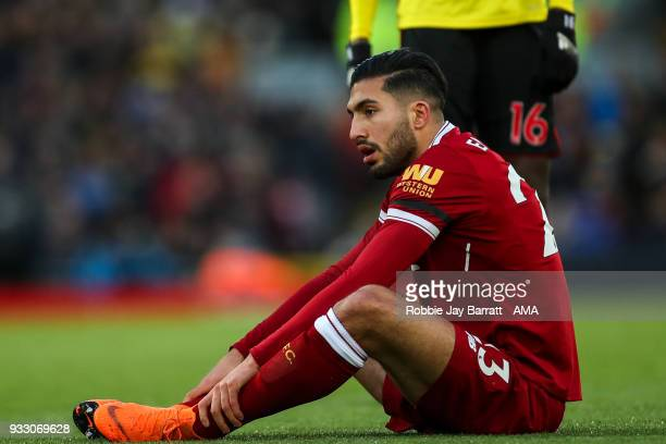 Emre Can of Liverpool picks up an injury which results in him being taken off during the Premier League match between Liverpool and Watford at...