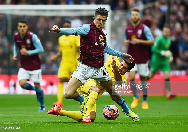 Emre Can of Liverpool tackles Jack Grealish of Aston Villa during the FA Cup Semi Final between Aston Villa and Liverpool at Wembley Stadium on April...