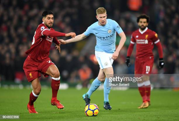 Emre Can of Liverpool tackles Kevin De Bruyne of Manchester City during the Premier League match between Liverpool and Manchester City at Anfield on...