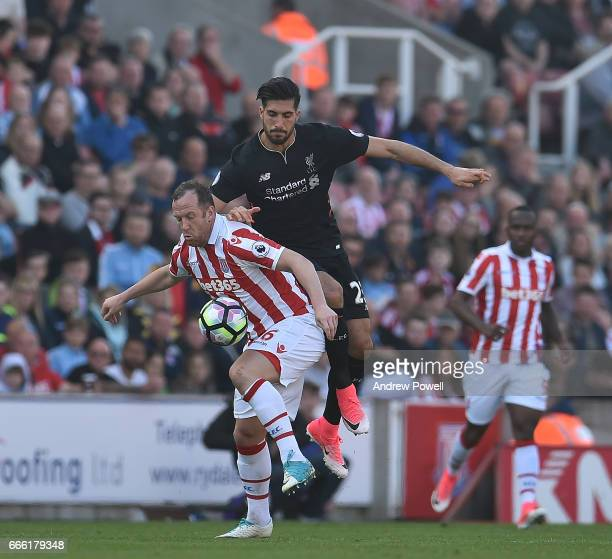 Emre Can of Liverpool with Charlie Adam of Stoke City during the Premier League match between Stoke City and Liverpool at Bet365 Stadium on April 8...
