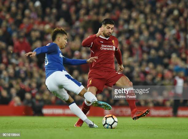 Emre Can of Liverpool with Mason Holgate of Everton during The Emirates FA Cup Third Round match between Liverpool and Everton at Anfield on January...