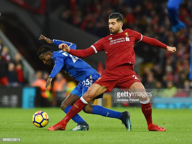 Emre Can of Liverpool with Wilfred Ndidi of Leicester during the Premier League match between Liverpool and Leicester City at Anfield on December 30...